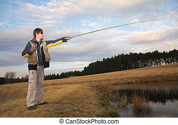 Flyfishing 11 - A fly fisherman casting a line in...
