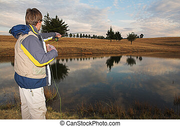 Flyfishing #14 - A fly fisherman casting a line in...