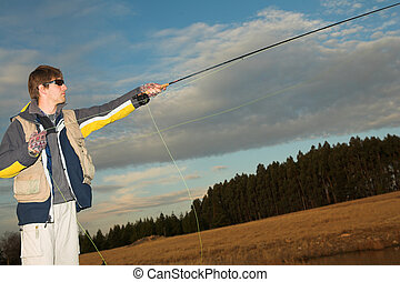 Flyfishing 15 - A fly fisherman casting a line in...