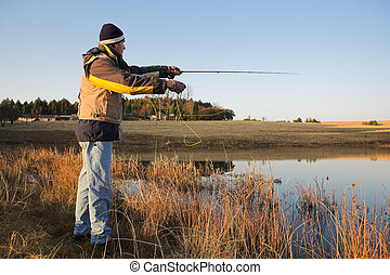 Flyfishing 16 - A fly fisherman casting a line in...