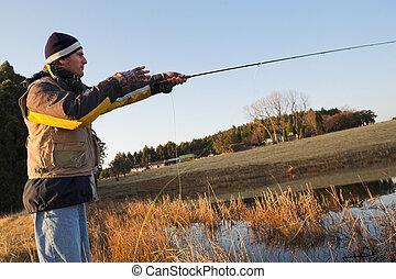 Flyfishing 17 - A fly fisherman casting a line in...