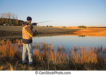 Flyfishing 19 - A fly fisherman casting a line in...