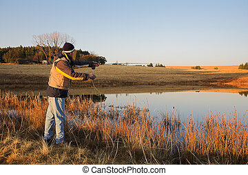 Flyfishing 22 - A fly fisherman casting a line in...