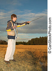 Flyfishing #23 - A fly fisherman casting a line in...