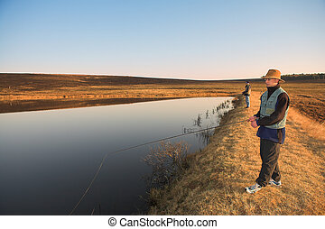 Flyfishing #25 - Fly fishermen casting a line in Dullstroom,...