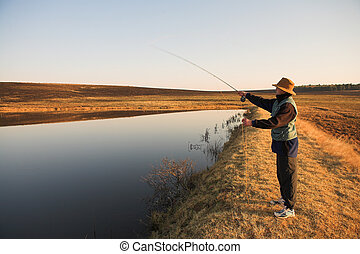 Flyfishing 26 - A fly fisherman casting a line in...
