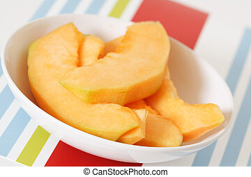 Cantaloupe slices - Slices of cantaloupe on a plate