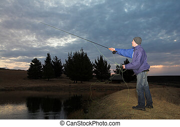 Flyfishing 28 - A fly fisherman casting a line in...
