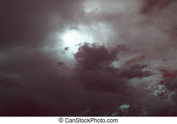 Storm Clouds - Abstract of storm clouds with red tint
