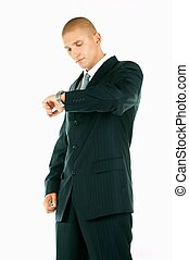 Businessman - A Young businessman looking at his hand watch