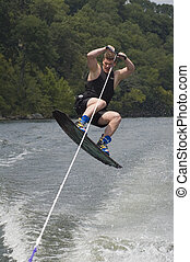 wakeboarder - man jumping on wakeboard