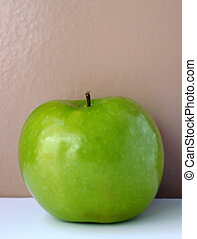 Country Apple - Wholesome fresh green apple on a beige and...