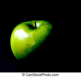 Apple Envy - Abstract image of a green apple in a moody dark...