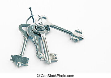 Sheaf of keys on a nail - Sheaf of keys  on white background