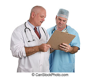 Doctors Confer Together - Two doctors conferring together on...