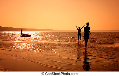 run - silhouette image of two girls playing on the beach