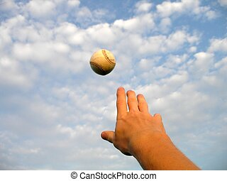 Aiming High - A baseball is thrown to the sky.