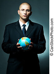 Businessman - A Young businessman holding a earth model