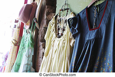 Treasures to be found - Dresses and accessories hanging up...