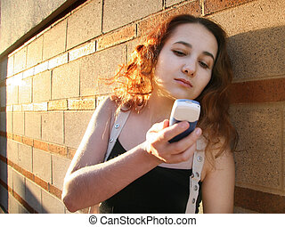 Girl with a phone - Girl in a city at sunset