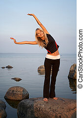 fitness - fit girl working out at the seashore