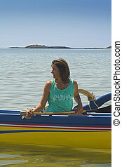 in pirogue - woman in pirogue