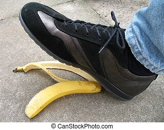 slip - foot about to tred on banana skin on pavement