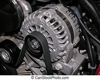 Alternator and belt - An Alternator used to power the...
