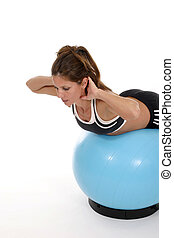 Woman Working Out On Exercise Ball 4 - Beautiful brunette...