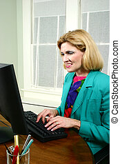 Beautiful Business Woman Typing And Smiling