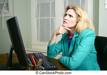 Beautiful Business Woman At Her Desk Thinking - Beautiful...