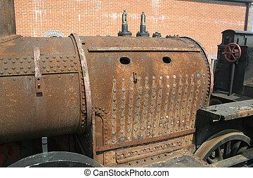 old boiler - rusty old steam engine boiler