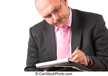 Concentrating on his notes - Businessman concentrating on...