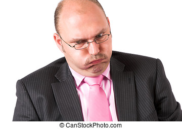 Difficult - Businessman pulling a face that signals trouble