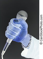 Digital Music - This is an image of a hand on a microphone.