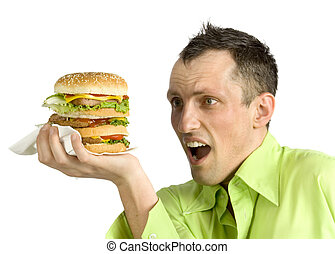 man with hamburger - hungry man looks at huge hamburger