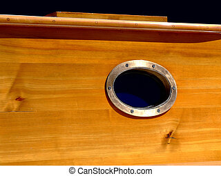 Yacht window - Close up shot of wooden yacht window