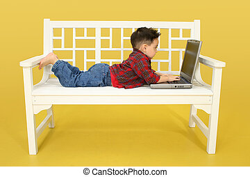 Toddler with Laptop - Addorable three year old boy working...