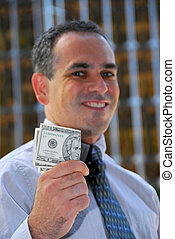 Businessman hold money - Businessman holding money