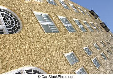 Yellow stucco wall - Yellow stucco building angled...