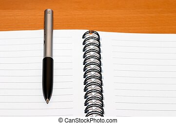 Empty blank ring, spiral notepad, one pen