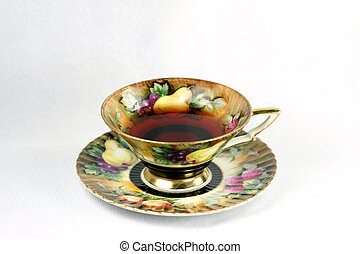 teacup with tea - antique teacup with tea