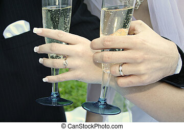 Wedding Day Drinks - A bride and Groom holding wine glasses...