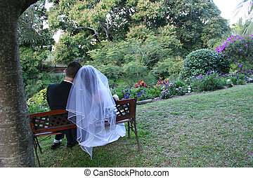 Bride & Groom - A bride and groom on a bench seat in a...