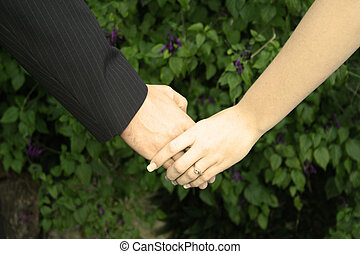 Holding Hands - A couple on their wedding day holding hands