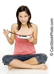Girl With Maki Rolls - A pretty young asian girl eating...