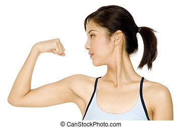 Fitness Girl - A pretty young asian woman flexing her arm