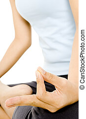 Yoga Meditation - A young woman sits in a yoga position and...