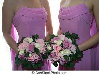 Bridesmaids - Two bridesmaids bodices and bouquets in pink