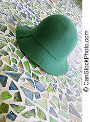 Green hat - Green felt hat on ceremic tiles